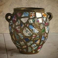 French pique assiette (mosaic incorporating broken pottery and crockery) with gold painted grout..