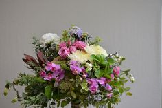Weaving through the design gorgeous vibrant mini cymbidiums. Daisy Hill, Special Flowers, Flower Delivery, Fresh Flowers, Bouquets, Orchids, Floral Wreath, Vibrant, Weaving