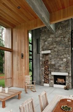 Choate selected maintenance-free materials for the project wherever possible, including the stone on this fireplace, which includes built-in storage for firewood. The stone extends 25 feet up to the wood-clad ceiling, emphasizing the home's grand scale.  Photo by: Phillip Spears