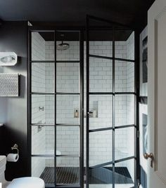 pin 01 Blackened steel window frames are having a massive moment put to use as shower doors and paired with a combination of white subway and black penny tile.