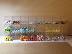clear AMAC boxes (#60420) from The Container Store. They are attached using u-glu dashes from JoAnn.