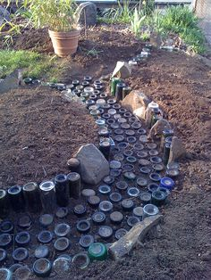 Wine Bottle Pathway and Raised Beds. This wouldn't take long. Wine Bottle Garden, Wine Bottle Art, Garden Paths, Garden Art, Garden Design, Bottle Trees, Raised Beds, Glass Bottles, Wine Bottles