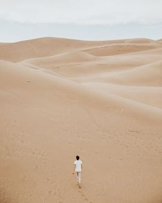 Walking alone through the dunes Lone Tree desert