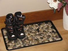 Make your own shoe mess mat - river stones and simple black mat