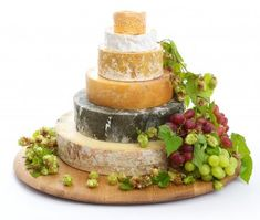Jersey Cheese Wedding Cake  A Cheese Wedding Cake of amber, gold, ivory and forest green!   A Champagne topping, layer of cream, finest Stilton, mild milky Yarg, a fruity cheddar and a smokey twist!     Petit Langres   St.Eadburgha   Colston Bassett Stilton   Smoked Worcester   Cornish Yarg   Lincolnshire Poacher