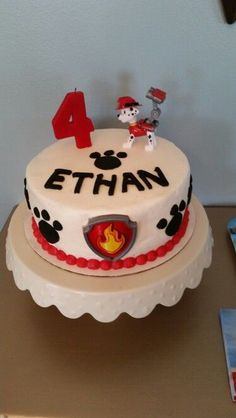 PAW Patrol birthday cake with a Marshall cake topper. So cute!