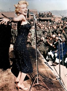 """Shortly after its establishment in 1941, the USO began enlisting comedians and other big name performers to entertain the troops on a variety of bases worldwide. In 1954, the same year that the first USO performance was broadcast on television, Marilyn Monroe traveled to Korea to sing for the troops there. Monroe's spur of the moment decision to make a USO appearance resulted in her arriving in Korea without her own band. The USO group """"Anything Goes,"""" came to the rescue, playing alongside…"""