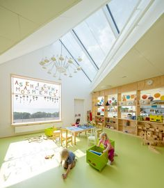 plywood shelves backed with glass create visibility between classroom and corridor spaces ~ Råå Day Care Center by Dorte Mandrup