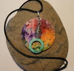 Hand painted Red, purple and orange Watercolor paper pendant necklace with a teal green wire wrapped shell charm