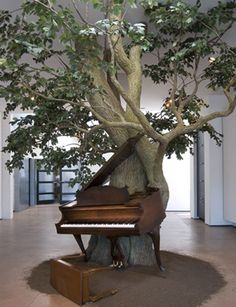 Sanford Biggers Blossom, 2007 Silk steel, wood, MIDI player piano system, zoopoxy 12 x 18 x 15 ft