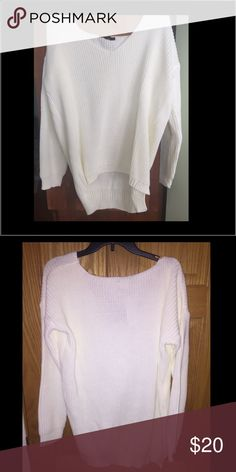 White Long Sleeve V-neck Sweater Brand new, never worn white long sleeve v-neck sweater with tags still attached.  Great sweater for fall/winter.  Fits as a small or medium, maybe even a large depending on the desire of wearing it as oversized or regular. I love the fit of the sweater but was looking for more of a cream color rather than white. Hoping someone else could love it as much as I do! Boohoo Tops