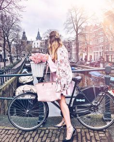 """Mi piace"": 836, commenti: 19 - The Blond Macaron (@theblondmacaron) su Instagram: ""Typical bike tourist: flowers,chanel bag,rockstuds amazing dress by @ellibeth_official """