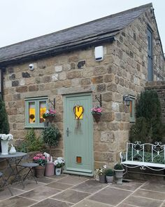 🌟Tante S!fr@ loves this📌🌟The shop at night time All locked up Chartwell green windows and door. Stone Cottages, Stone Houses, Green Windows, Windows And Doors, Chartwell Green Front Door, Green Front Doors, English Country Cottages, Cottage Interiors, Rustic Outdoor