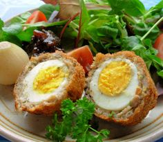 "Freshly boiled eggs are encased in a herb flavoured sausage ""jacket"" and are then deep-fried until golden and crisp, delicious! Scotch eggs are not Scottish, The word Scotch is an old English word meaning to chop or mince, and obviously, the eggs are covered with ""chopped or minced"" pork sausage meat, hence the name Scotch Eggs. PRINTED"