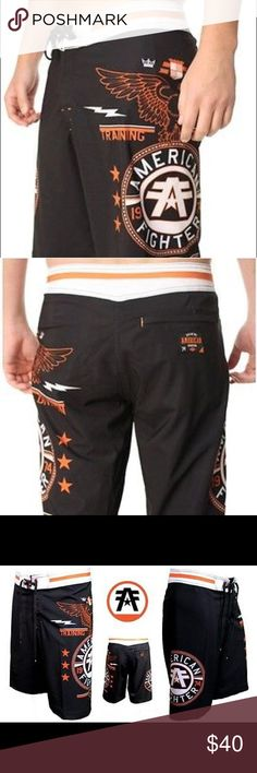 American Fighter Men Board Shorts American Fighter by Affliction Men's board shorts. Crest of Truth. 100% Polyester. Draw String Waist Super comfy. Black white and orange. No Trades. Affliction Shorts Athletic