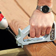 A jig and screw kit allows fast installation of decking without pilot holes. The secret of the handy hidden fastener system is an augering screw that hogs out wood as it's driven, along with a special tool that holds it at the proper angle and acts as a b