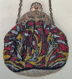 Charming Vintage Edwardian Beaded Purse with red, slate blue, yellow and black beadwork, a filigree frame and blue silk lining.