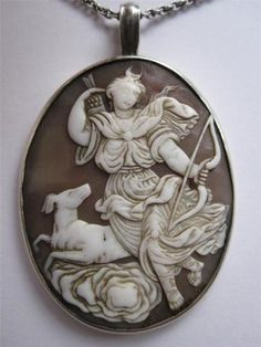 Victorian Silver Carved Shell Cameo of Goddess Diana The Huntress Pendant | eBay  ~  While the detail in Artemis' (Diana) face seems to be somewhat smoothed I think (as am amateur) that the overall composition and execution of this cameo is absolutely amazing.  Her arm seems to be reaching off of the cameo through the perspective that was achieved in the design of the carving.
