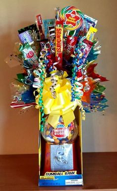 Made for my grandsons birthday. A candy bouquet displayed on top of a gum ball bank.  Took a long time but he loved it!