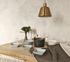 Iittala Christmas Home. Iittala + Time of the Aquarius collaboration. Sarpaneva cast iron pot, Teema dishes and pitcher, Nappula candleholders, Sarjaton glasses.
