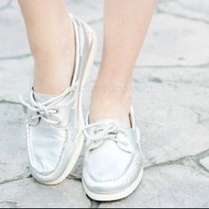 Silver Sperry top-siders Great condition! No rips tears or stains.  Silver sperry top siders non marking with white bottom Sperry Top-Sider Shoes