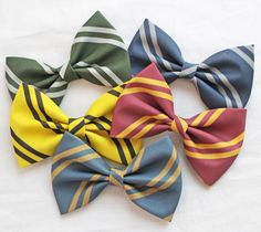 Hogwarts House Colors Bows! Gryffindor Ravenclaw Slytherin Hufflepuff PICK ONE by FrostedDonutDesigns on Etsy https://www.etsy.com/listing/187002447/hogwarts-house-colors-bows-gryffindor