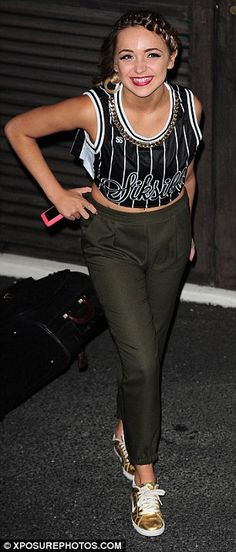 Fashionista: Lauren Platt stepped out in a cropped jersey and gold trainers...