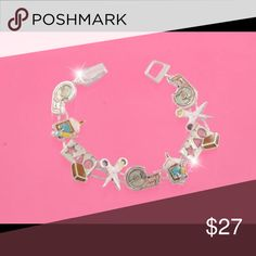 """Crafters pay attention to this adorable craft brac Multicolored enameled 1/2"""" school, craft or scrapbooking-themed emblems such as tape, glue, stencil rulers and scissors link to form this 7 1/4"""" long silvertone bracelet with a magnetic closure. Jewelry Bracelets"""