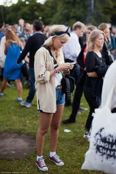 oversized men's button up top and cute high-waisted denim shorts. I love this festival outfit.