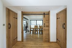 Contemporary barn conversion install Heritage's interior solid oak doors and solid oak flooring