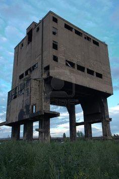 http://us.123rf.com/400wm/400/400/skopal/skopal1008/skopal100800068/7711226-abandoned-factory--concrete-ruins-in-industrial-district.jpg