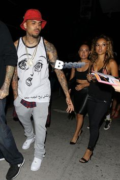 Chris Brown and Karrueche Tran arrive at Bootsy Bellows nightclub in West Hollywood.  The 25-year-old wore a teary eyed jersey, grey sweatpa...