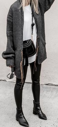 everyday street style. gray chunky cardigan. white blouse. leather look leggings. ankle boots.