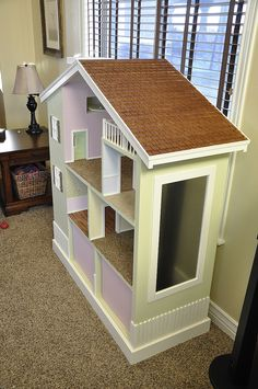 I think I will use this idea to refurbish my daughter's doll house...  My Bookshelf Dollhouse