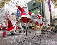 Santa Claus rides a tricycle in Seoul