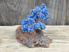 Check out this item in my Etsy shop https://www.etsy.com/listing/216215189/blue-wire-tree-miniature-bonsai-wire