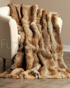 This natural rabbit fur blanket / throw is constructed with exquisite workmanship with the finest full rabbit pelts. Available in a variety of colors and sizes.