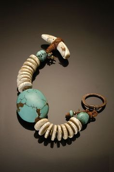 Could work for a man without the focal bead, I think.  Bracelet | Chris Carlson.  Naga shell & turquoise
