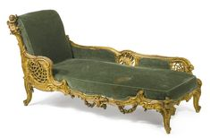 A FINELY CARVED ROCCOCO STYLE GILTWOOD CHAISE LOUNGE PARIS, CIRCA 1900