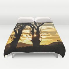 Golden evening Duvet Cover by Pirmin Nohr - $99.00 A nice evening in my homeland. Some trees amidth of vineyards in the setting sun. In the backgrounds are some mountains. Unedited photo.   Sunset, sundown, evening, trees, silhouettes, clouds, sky, yellow, black, golden, moody,  nature, landscape, photography