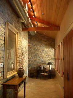 stone walls and floor with warm wood ceiling.....perfect combination!