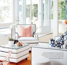 Orange cushions, outdoor fabric, can't read the name of it in the text. Style at Home