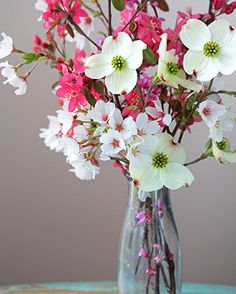With some cherry blossoms to freshen up the dark furniture of the bedroom.