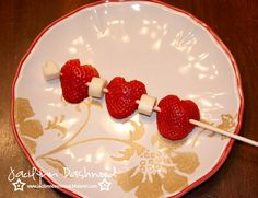 Healthy School Valentine's snack: To make the strawberries look like hearts I simply cut the strawberries in half and then cut a V notch out of the top. These were a big hit with the kids...after all who doesn't like fruit on a stick?!