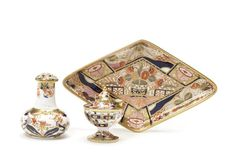 A Spode dish, a lizard bottle and stopper and an inkwell and a cover, circa 1806-1810 The dish of diamond shape, decorated in pattern 963 with Imari colours, 25.6cm diam, the lizard bottle, 10.5cm high and inkwell, 8.4cm high, decorated in pattern 967 in blue, red and green colours, all marked SPODE