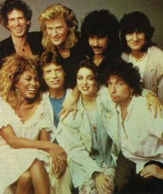 With some of the artists that appeared on Live Aid. The people in  the first two pics are Keith Richards, Darryl Hall, John Oates,   Ron Wood, Tina Turner, Mick Jagger, Maddy,and Bob Dylan.   In the third pic, Madonna poses with her own musicians