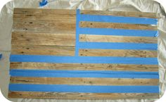 taping the wood pallet to make an american flag