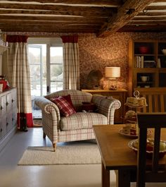 Cosy cottage with plaid couch