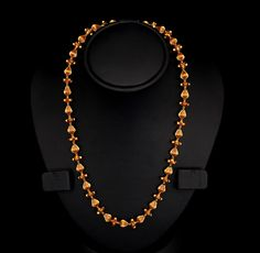 Beautiful Ruby Gold Chain. Combining the two elements of ruby studded nuggets and pear-shaped beads set in alternate order, this antique finish gold chain is highly attractive. Made of 22 carat gold and featuring a regular pattern, you would love to wear it every time you go out.