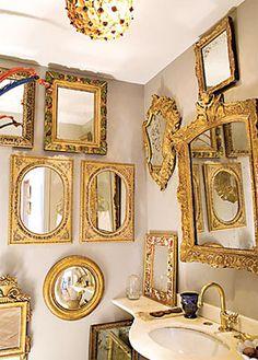 Espelhos com molduras entalhadas, uma coleção que decora com bom gosto